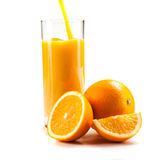 Fresh healthy orange juice and slices of oranges Stock Photography