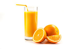 Fresh healthy orange juice and slices of oranges Stock Photos