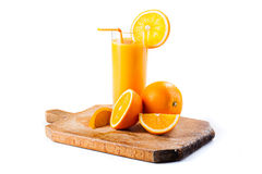 Fresh healthy orange juice and slices of oranges Stock Images