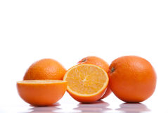 Fresh healthy Oranges lying on white background Stock Image