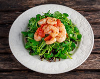 Fresh Healthy Prawns black rice salad on white plate Royalty Free Stock Images