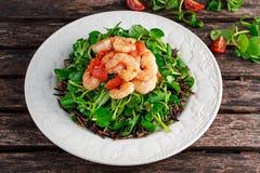 Fresh Healthy Prawns black rice salad on white plate Royalty Free Stock Photography