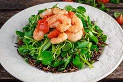 Fresh Healthy Prawns black rice salad on white plate Royalty Free Stock Photos