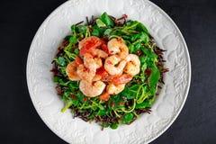 Fresh Healthy Prawns black rice salad on white plate Stock Image