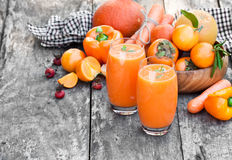 Fresh healthy pulpy cocktail with orange fruits and berries and Stock Photos
