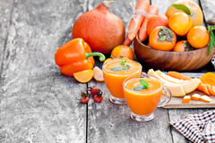 Fresh healthy pulpy cocktail with orange fruits and berries and. Vegetables Stock Photography