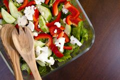 Fresh healthy salad from cauliflower sweet red pepper cucumber a. A nutritious low-calorie salad made from freshly sliced vegetables, consisting of cucumbers Royalty Free Stock Photos
