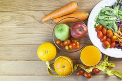 Fresh healthy salad with different fruits and vegetables on wooden Stock Photos