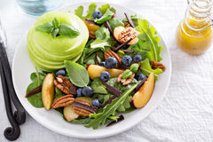 Fresh healthy salad with greens and apple Stock Photo