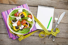 Fresh healthy salad and notepad for copy space Royalty Free Stock Photos