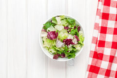 Fresh healthy salad over white wooden table Royalty Free Stock Photos