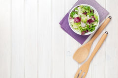 Fresh healthy salad over white wooden table Royalty Free Stock Images