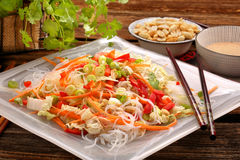 Fresh healthy salad with rice noodles and nuts Stock Images