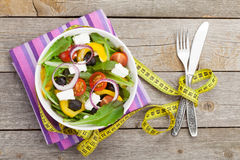 Fresh healthy salad, silverware and measure tape Stock Photos
