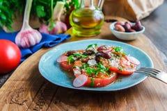 Fresh healthy salad with tomatoes, homemade dish. Horizontal Stock Photography