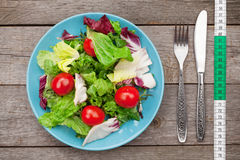Fresh healthy salad, tomatoes and kitchen utensils Royalty Free Stock Photography