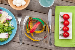 Fresh healthy salad, tomatoes, mozzarella and measuring tape. He Stock Image