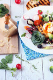 Fresh Healthy Salad with Tomatoes Radishes Poached Egg Parmesan Cheese. Olives and Chicory Royalty Free Stock Images