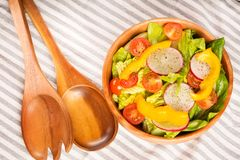 Fresh healthy salad top view on cotton napkin background. Stock Images