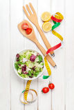 Fresh healthy salad, utensils and tape measure Stock Photography