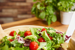 Fresh healthy salad on wooden table. View from above with copy s Stock Image
