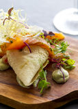 Fresh healthy salmon salad. Displayed on a wooden serving board Stock Image