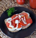 Fresh healthy sandwich with sliced tomato,eggs on a plate and tomato smoothie Stock Photography