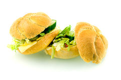 Fresh healthy sandwiches filled with lettuce. And cheese isolated on white background stock image