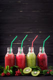 Fresh healthy smoothies from different berries. On a dark background royalty free stock photos