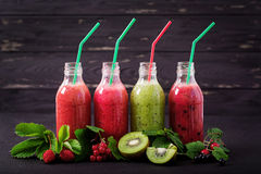 Fresh healthy smoothies from different berries Royalty Free Stock Photos