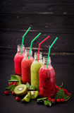 Fresh healthy smoothies from different berries. On a dark background Royalty Free Stock Images