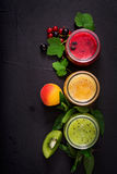 Fresh healthy smoothies from different berries. On a dark background. Diet menu. Proper nutrition. Flat lay. Top view Stock Images