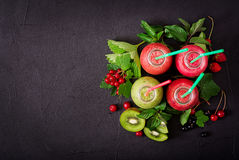 Fresh healthy smoothies from different berries. On a dark background. Flat lay. Top view stock photo