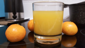 Fresh and healthy tangerine fresh juice. On this photography you can see some fresh tangerine juice. The juice is made in the professional kitchen. Great picture stock image