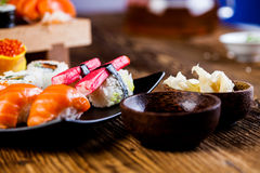 Fresh, healthy and tasty oriental sushi with seafood Stock Photos