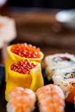 Fresh, healthy and tasty oriental sushi with seafood Stock Photography