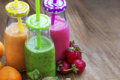 Fresh healthy three types of fruits juices or smoothies bottles, Stock Image