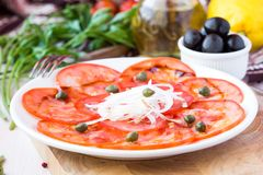 Fresh healthy tomato carpaccio with capers, balsamic vinegar Stock Images