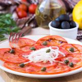 Fresh healthy tomato carpaccio with capers, balsamic vinegar Royalty Free Stock Photo