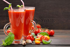 Fresh healthy tomato smoothie juice on wooden background Stock Images