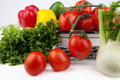 Fresh and healthy vegetables food. Fresh and healthy vegetables on a weighing scale Royalty Free Stock Photography