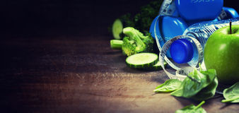 Fresh healthy vegetables, water and measuring tape. Health and d Stock Images