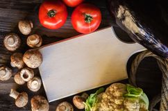 Fresh healthy vegetables on wooden table with white trencher. Rustic style. Royalty Free Stock Photos