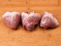 Fresh heart on  kitchen cutting board. Royalty Free Stock Photography