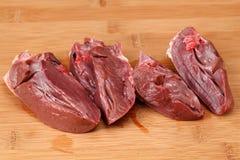Fresh heart on  kitchen cutting board. Royalty Free Stock Photo