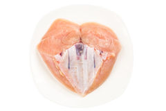 Fresh heart shaped skinless chicken breast meat with keel bone Royalty Free Stock Photo