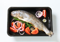 Fresh herb-stuffed trout and vegetable Royalty Free Stock Photos