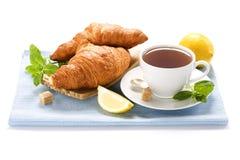 Fresh herbal mint tea. Herbal tea, mint, lemon and croissants on blue napkin stock images