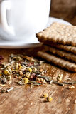 Fresh herbal tea and some cookies. Cup of fresh herbal tea and some cookies closeup on wooden table Stock Photo