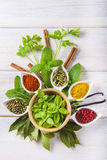 Fresh Herbs And Spices On A White Wooden Background Stock Images